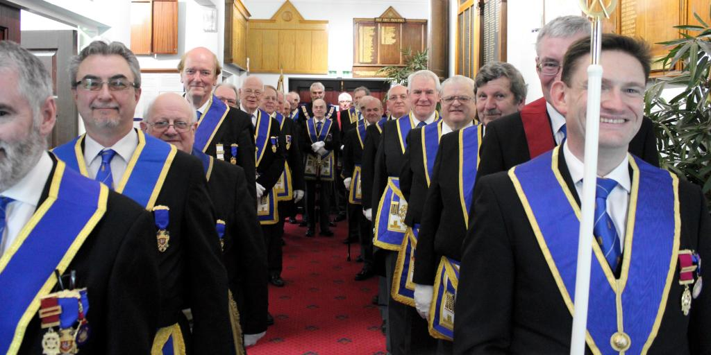 The Provincial Team escorts the Provincial Grand Master into the Lodge at our Centenary Celebration